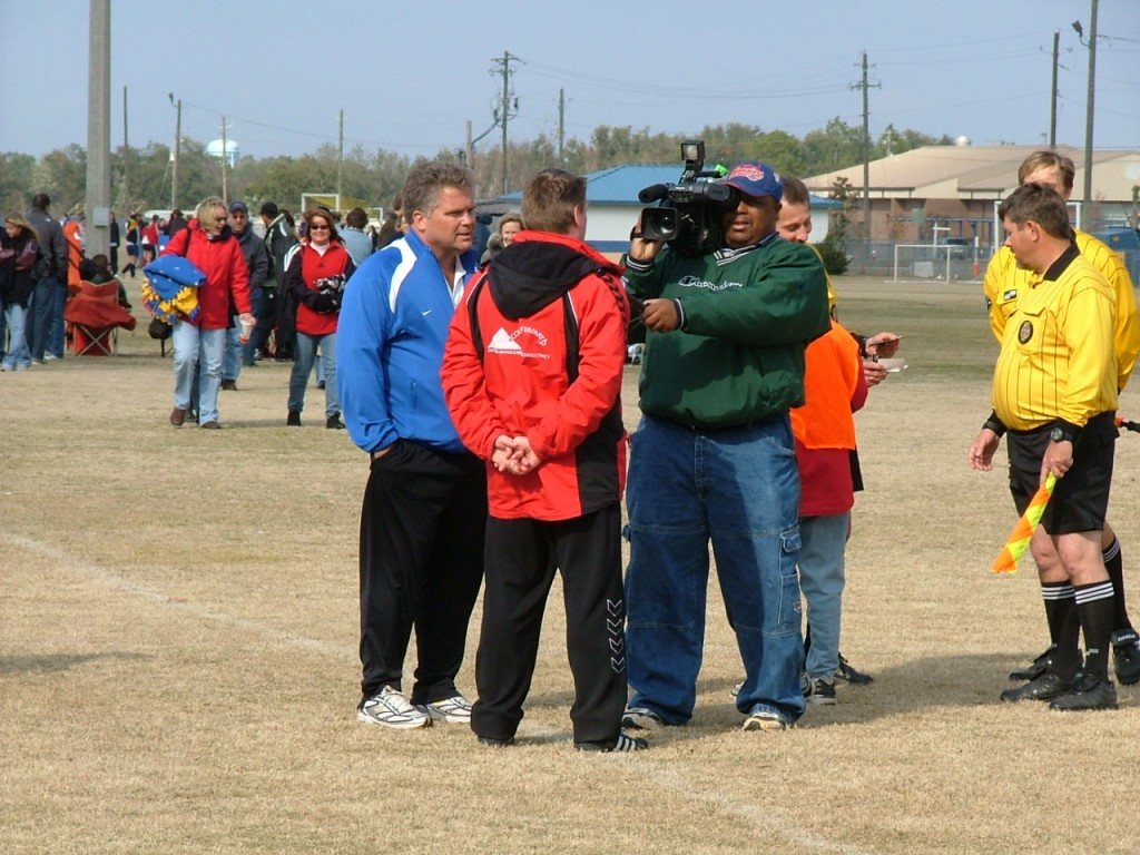 Press officer at an international youth football tournament in Pensacola - America.